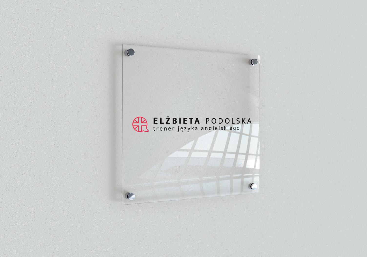 Elżbieta Podolska - projekt tabliczki ściennej z nowym logo