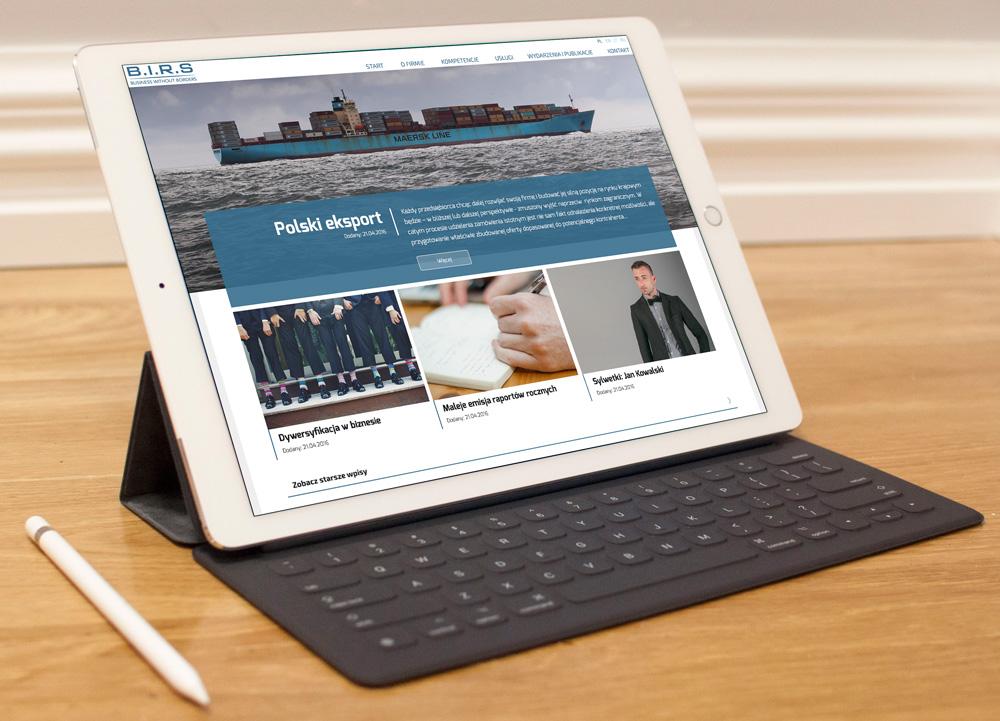 BIRS - wizualizacja strony na mockupie z tabletem