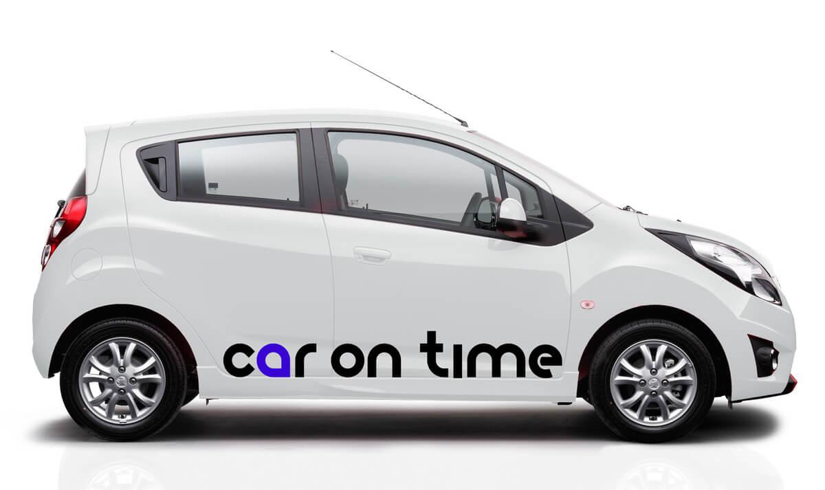 Car On Time - wizualizacja zaprojektowanego loga na samochodzie firmowym. Gliwice, Śląsk